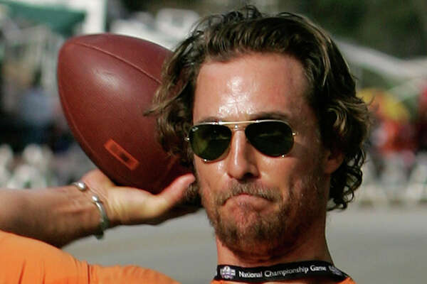Actor and Texas alumnus Matthew McConaughey tosses a football around with fellow fans in the parking lot before Texas meets Southern California in the Rose Bowl, the national championship college football game, Wednesday, Jan. 4, 2006, in Pasadena, Calif.
