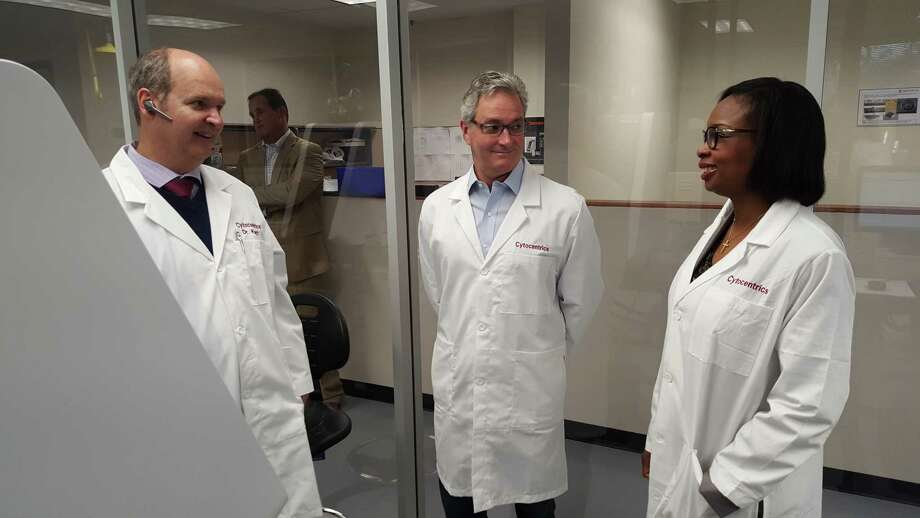 San Antonio Mayor Ivy Taylor visits with Dr. Thomas Knott (left) while touring Cytocentrics' San Antonio facility in March. Cytocentrics, biomedical firm that started in Germany, is an example of a recent foreign direct investment in San Antonio. Photo: City Of San Antonio