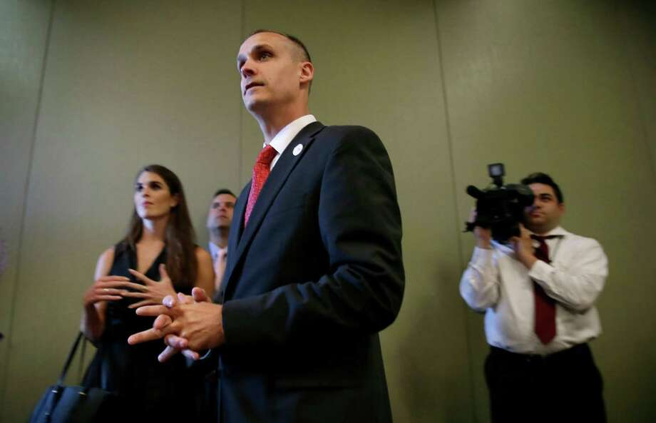 In this photo taken Aug. 25, 2015, Republican presidential candidate Donald Trump's campaign manager Corey Lewandowski watches as Trump speaks in Dubuque, Iowa. Florida police have charged Lewandowski with simple battery in connection with an incident earlier in the month involving a reporter. (AP Photo/Charlie Neibergall) ORG XMIT: IACN202 Photo: Charlie Neibergall / AP
