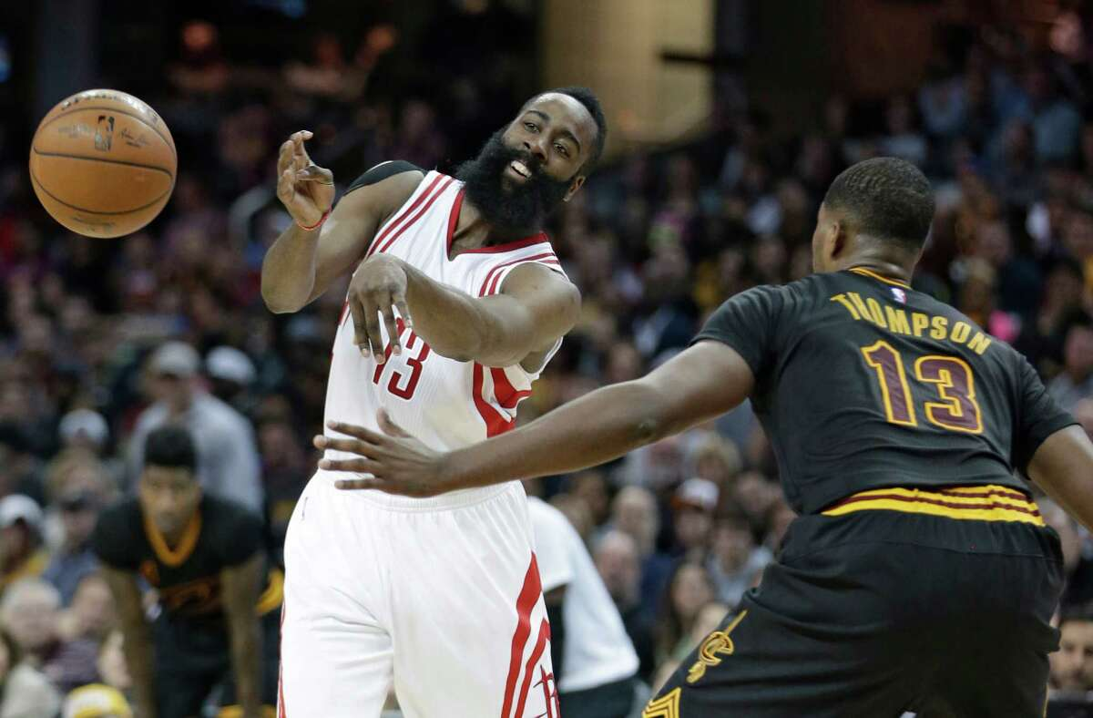 Houston Rockets' James Harden, left, passes against Cleveland Cavaliers' Tristan Thompson during the first half of an NBA basketball game Tuesday, March 29, 2016, in Cleveland.