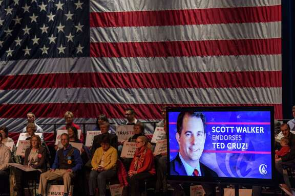 A live radio feed of Wisconsin Gov. Scott Walker's endorsement of Ted Cruz is played before a Cruz rally Tuesday at the Sharon Lynne Wilson Center for the Arts in Brookfield, Wis.