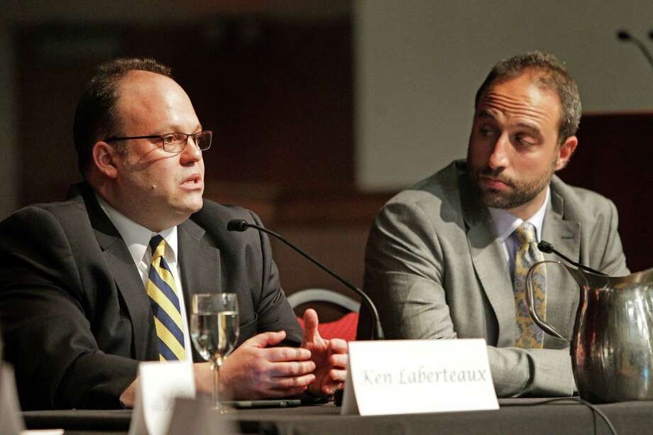Ken Laberteaux of Toyota, left, and Joshua Shank of Los Angeles' transportation authority were part of the panel. Photo: Steve Gonzales / © 2016 Houston Chronicle