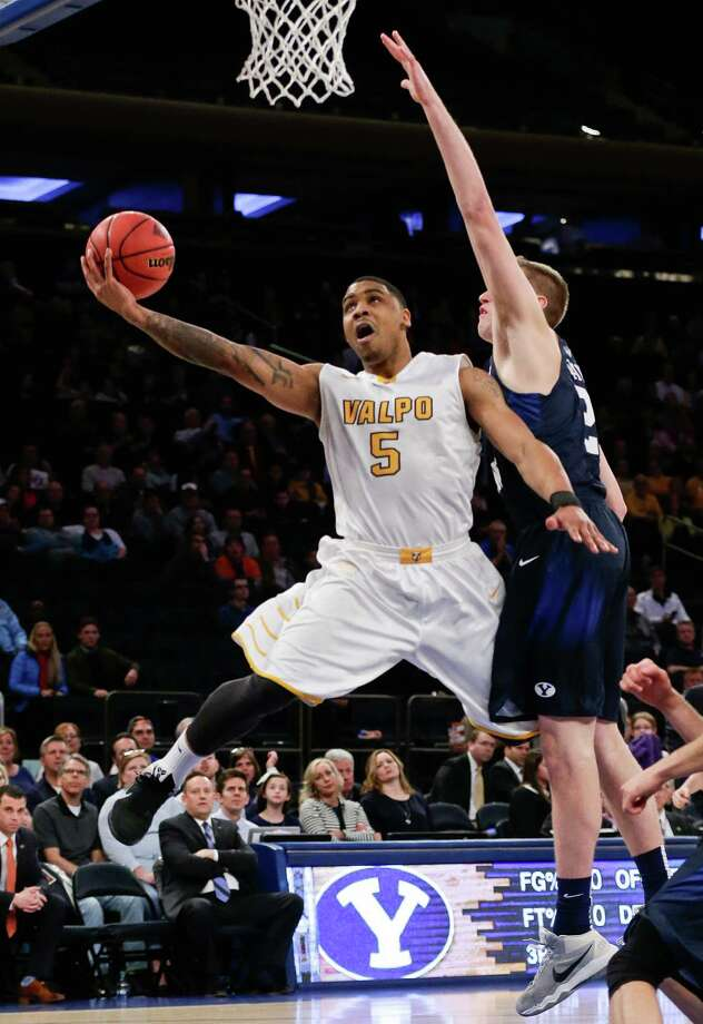Valparaiso's Darien Walker (5) drives past BYU's Kyle Davis (21) during the first half of an NCAA college basketball game in the semifinals of the NIT on Tuesday, March 29, 2016, in New York. (AP Photo/Frank Franklin II) ORG XMIT: MSG102 Photo: Frank Franklin II / AP