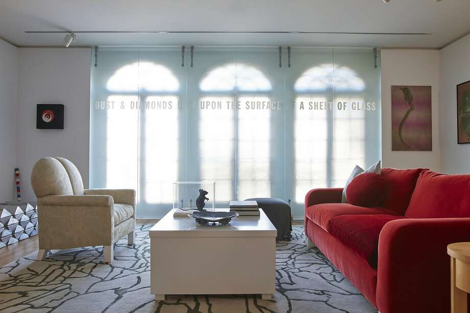 "The living room features ""Dust & Diamonds"" by Lawrence Weiner and furniture designed by Roy McMakin. Photo: Phil Harvey / Special To The Chronicle"