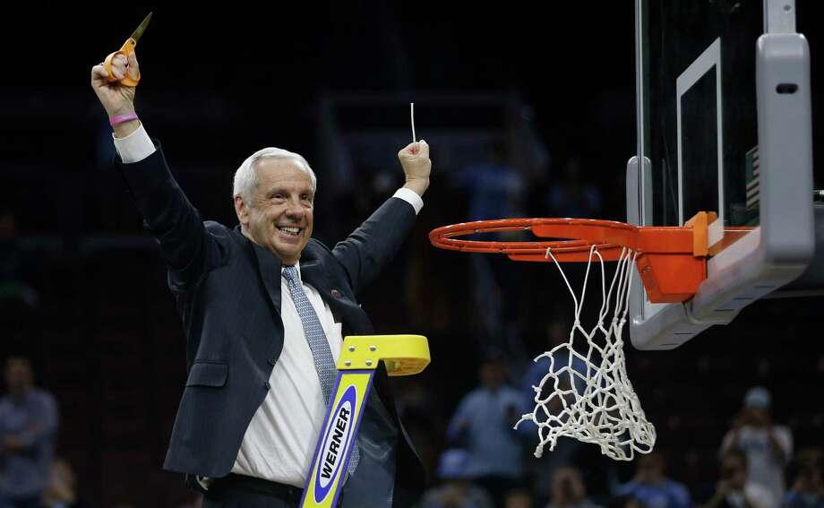 North Carolina head coach Roy Williams reacts after cutting the net after a regional final against Notre Dame in the NCAA Tournament on March 27, 2016, in Philadelphia. North Carolina won 88-74 to advance to the Final Four. Photo: Matt Rouke /Associated Press