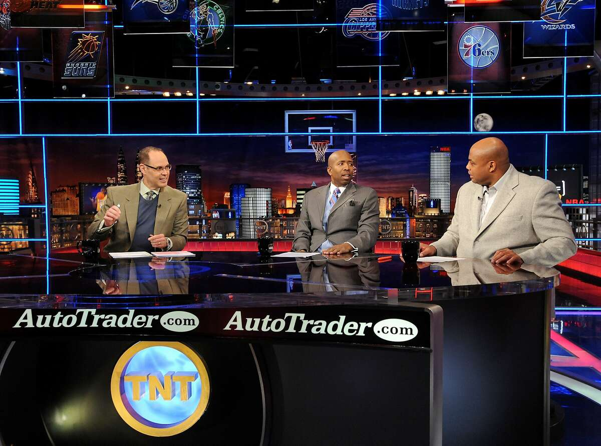 In this file photo, Inside the NBA host Ernie Johnson Jr., left, and analysts Kenny Smith, center, and Charles Barkley are shwon on the set at the TNT studios in Atlanta.