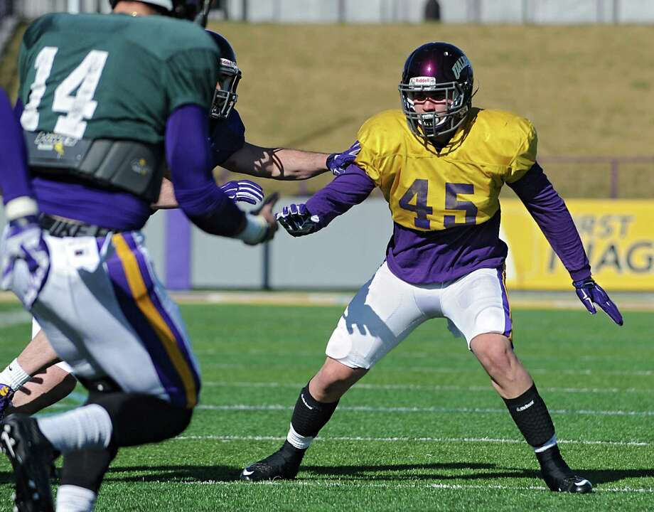 University at Albany defensive lineman Skylor Clinton, right, practices with his team on Tuesday, March 29, 2016 in Albany, N.Y. Clinton is new to the team after transferring from Wyoming. (Lori Van Buren / Times Union) Photo: Lori Van Buren / 10035984A