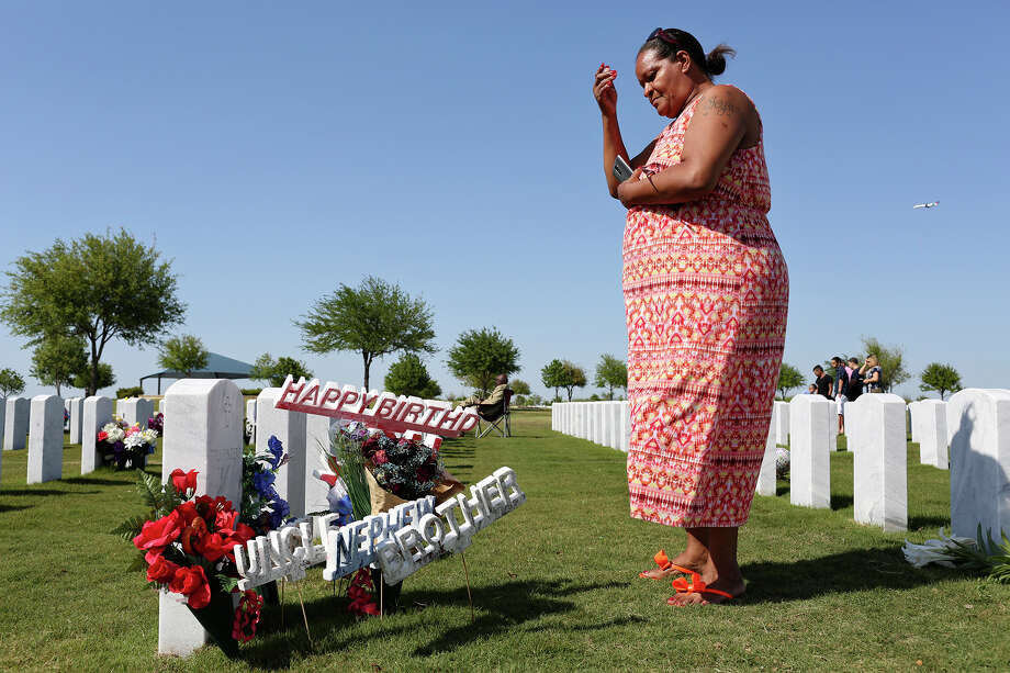 Olivia Fenner visits the grave of her son, Tru Sincere Trusty, on Easter Sunday at Fort Sam Houston National Cemetery. The 16-year-old was shot and killed last September. Photo: Photos By Lisa Krantz / San Antonio Express-News / SAN ANTONIO EXPRESS-NEWS