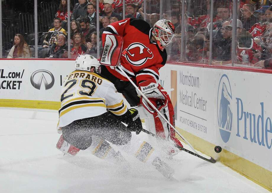 NEWARK, NJ - MARCH 29: Keith Kinkaid #1 of the New Jersey Devils shoots the puck away from Landon Ferraro #29 of the Boston Bruins during the first period at the Prudential Center on March 29, 2016 in Newark, New Jersey.  (Photo by Bruce Bennett/Getty Images) ORG XMIT: 574715653 Photo: Bruce Bennett / 2016 Getty Images