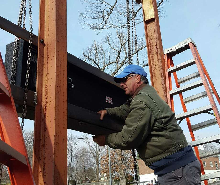 Brian Barzee from Northeast Scoreboards of Hadlyme works on replacing the old electronic scoreboards at McGuane Field in Noroton Heights last Friday. Photo: Thane Grauel / Hearst Connecticut Media / Darien News