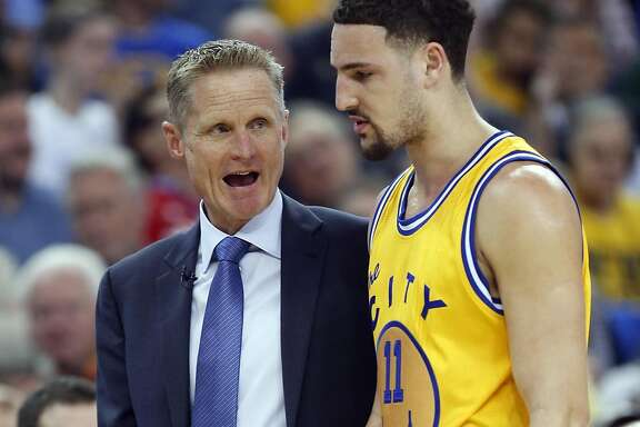 Golden State Warriors' head coach Steve Kerr talks with Klay Thompson in 1st quarter against Washington Wizards during NBA game at Oracle Arena in Oakland, Calif., on Tuesday, March 29, 2016.