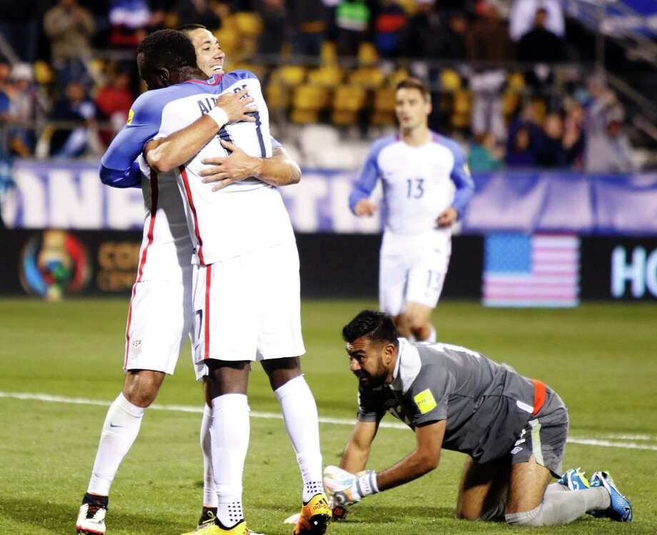 Clint Dempsey and Jozy Altidore (17) embrace after Altidore beat Guatemalan goalie Paulo Matta for the Americans' fourth goal Tuesday. Photo: PAUL VERNON, Stringer / AFP or licensors
