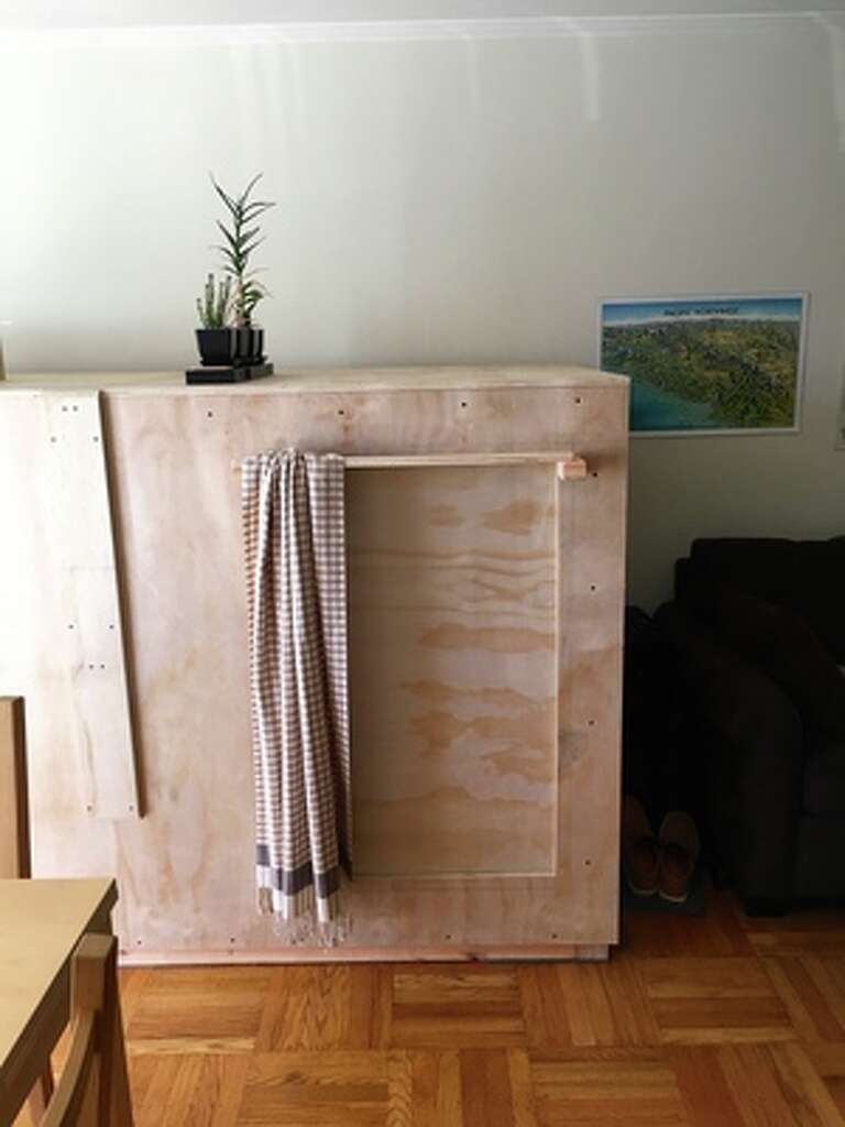 Illustrator Peter Berkowitz is avoiding San Francisco's high rent by paying only $400 to live in a box in a friend's living room. Photo: Peter Berkowitz