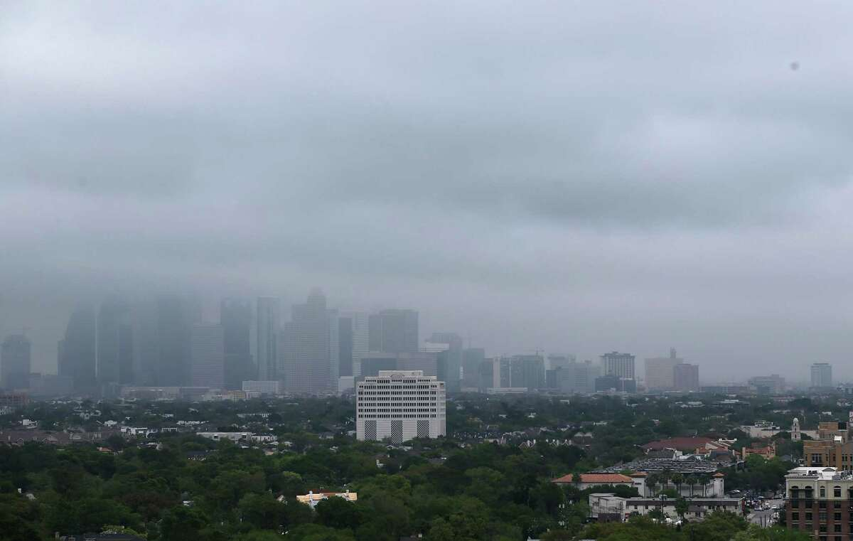View of a cloudy downtown skyline from the current roof of the The River Oaks, new development on Westheimer Road on Tuesday, March 29, 2016, in Houston.