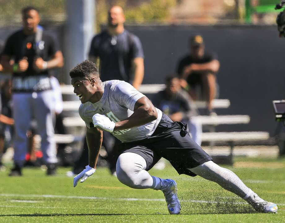 UCLA linebacker Myles Jack runs drills in the team's NFL football pro day at Spaulding Field in Los Angeles on Tuesday, March 15, 2016. (AP Photo/Damian Dovarganes) Photo: Damian Dovarganes, AP