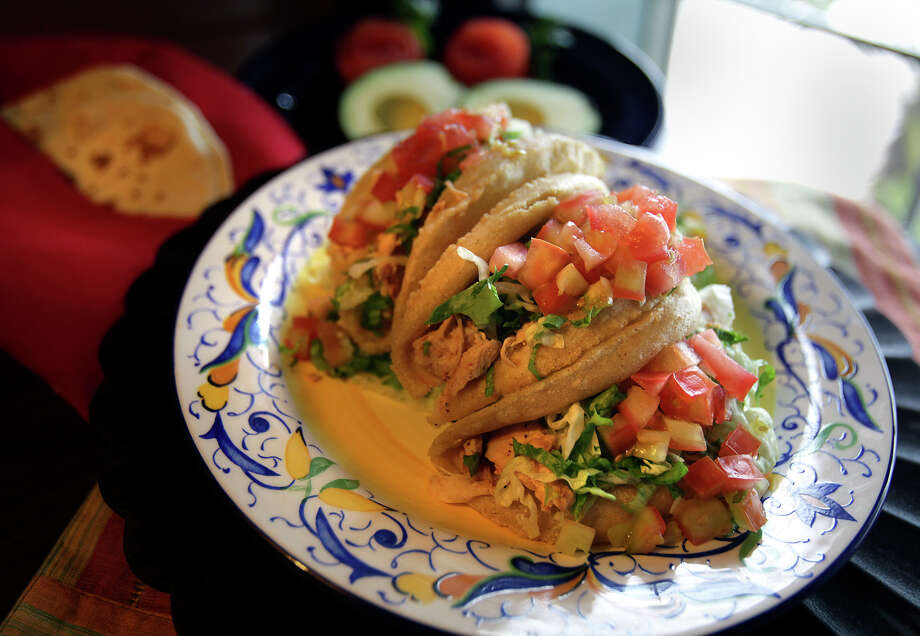 Puffy tacos are a San Antonio tradition worthy of a Bobby Flay Throwdown. Find some of the best at Henry s Puffy Tacos. Photo: Bob Owen /San Antonio Express-News / San Antonio Express-News