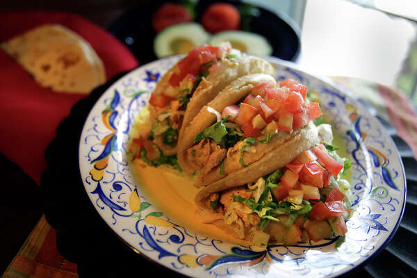 Puffy tacos are a San Antonio tradition worthy of a Bobby Flay Throwdown. Find some of the best at Henry s Puffy Tacos.