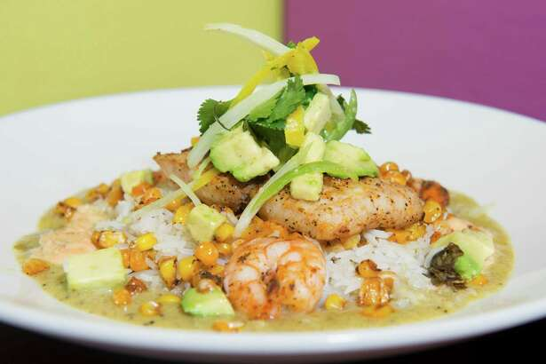 An adobo seafood dish is pictured with mahi mahi and shrimp over a bed of basmati rice and covered with a poblano and chipotle aioli cream sauce at Leon Valley Cafe.