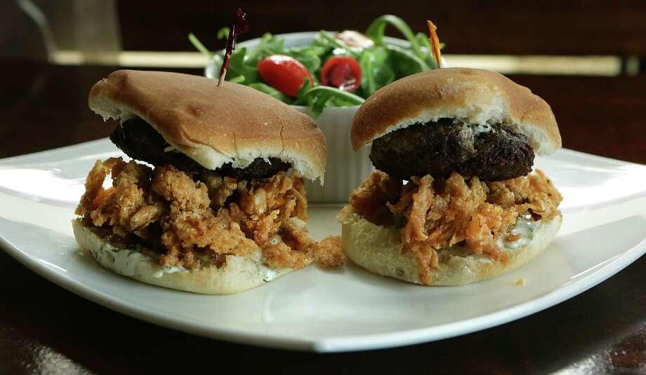 The burger sliders include crunchy onion rings. Photo: Bob Owen /San Antonio Express-News / San Antonio Express-News