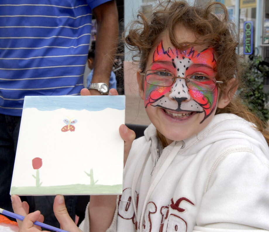 The Grand Kids Festival returns to Galveston April 2. Savannah Schneider shows off her tile painting that she created at an earlier Grand Kids Festival. Photo: Kim Christensen, Freelance / Freelance