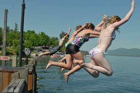 Young adults cool off by jumping off a pier on Lake George, NY on May 25, 2010. (Lori Van Buren / Times Union)