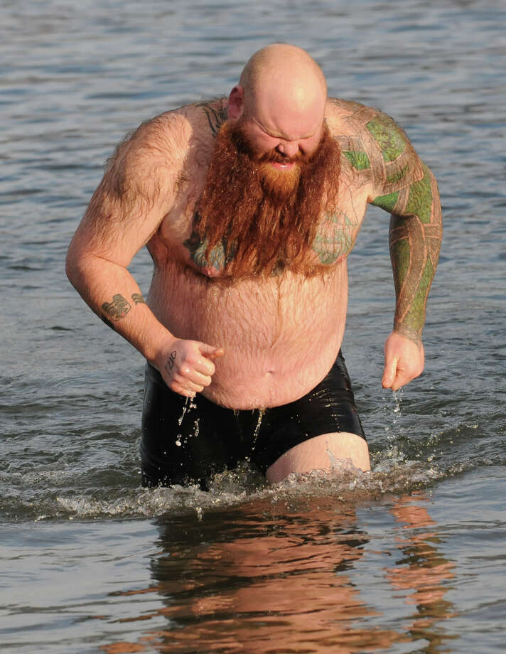 Norman Pendergraft of Clifton Park participates in the annual Lake George Polar Plunge Sunday, Jan. 1, 2012 in Lake George, N.Y. (Lori Van Buren / Times Union) Photo: Lori Van Buren / 00015904A