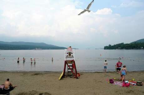 Beach goers get into the water off Million Dollar Beach on Monday, June 24, 2013 in Lake George, NY.  The State Department of Environmental Conservation held a press conference on Monday at the beach to announce improvements being planned.  (Paul Buckowski / Times Union) Photo: Paul Buckowski / 00022945A