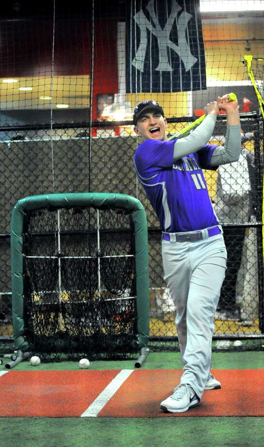 Westhill's Johnny Spoto plays a simulated game on the Hit Trax system during the second annual FCIAC Baseball Media Day in Stamford on Tuesday. Photo: Matthew Brown / Hearst Connecticut Media / Stamford Advocate
