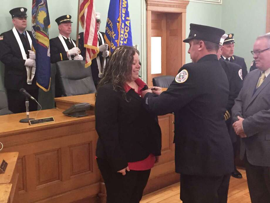 Jessica Fiffe, left, was sworn in as a Cohoes firefighter Wednesday joining her husband, firefighter Tom Fiffe Sr., right, on the job. They are the department's first married couple. (Kenneth C. Crowe II / Times Union)