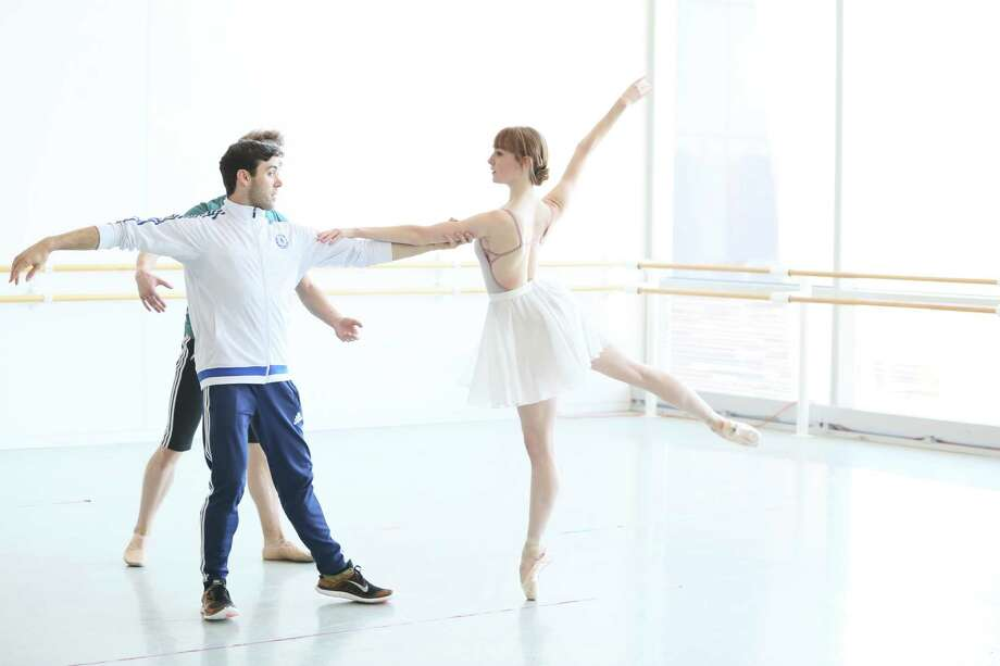 """Connor Walsh works with Houston Ballet dancer Natalie Varnum, one of five company members in his new choreography for """"REACH."""" Photo: Amitava Sarkar"""