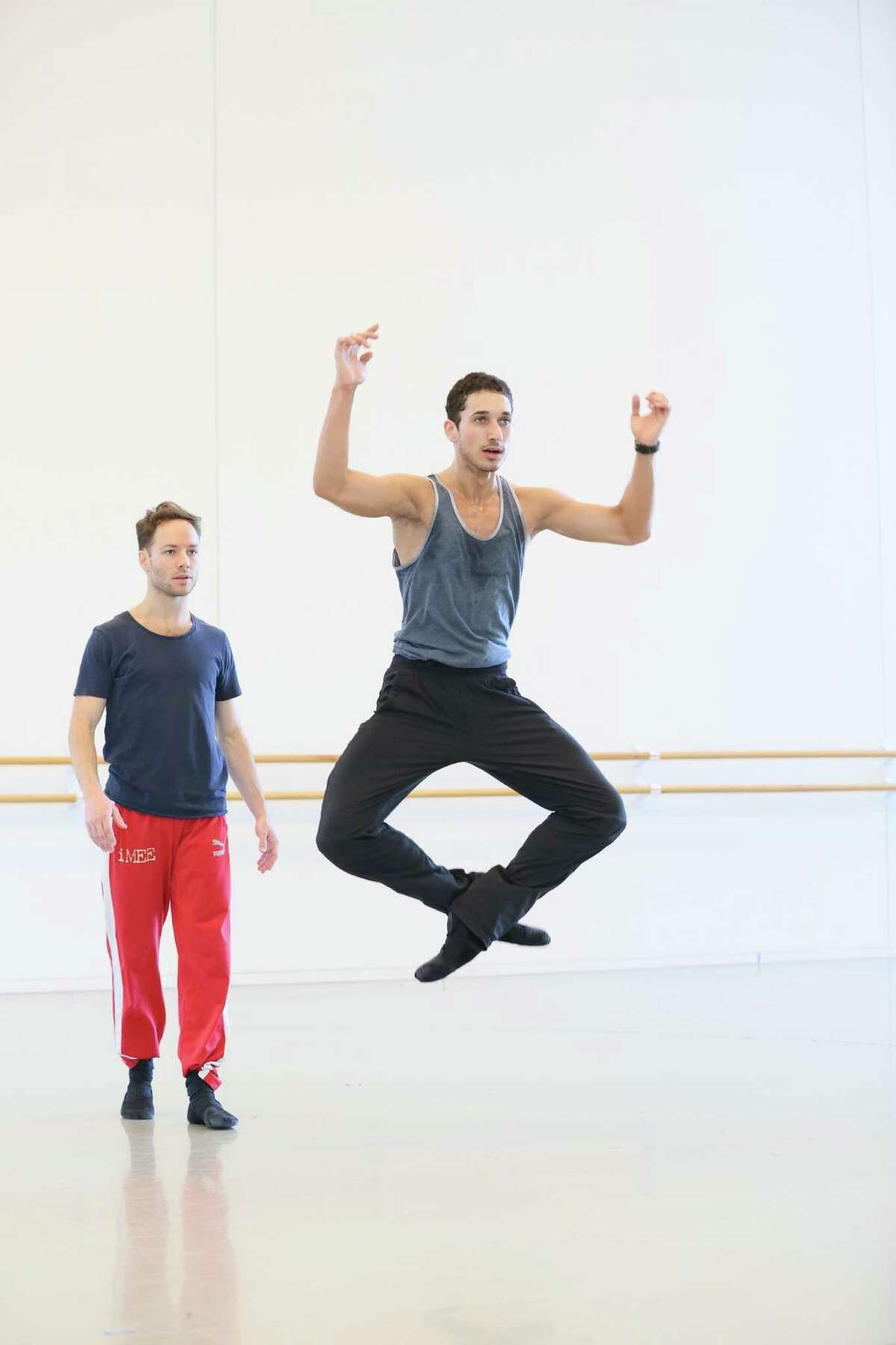 Oliver Halkowich, rear, rehearses dancer Shahar Dori, one of three Houston Ballet company members who will perform in Halkowich's new choreography for Project REACH.
