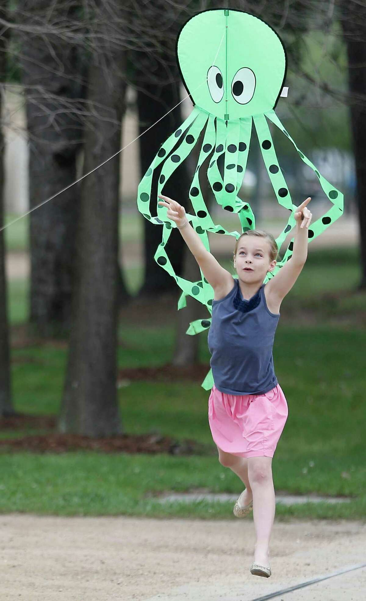 Mary Elizabeth Garvey , age 9, flies an octopus kite at Hermann Park on Monday, March 14, 2016 in Houston, TX. Mary Elizabeth was there to help promote the 3rd Annual Hermann Park Conservatory Kite Festival to be held Sunday April 3, 2016 from 10 am to 5 pm. ( Photo by Thomas B. Shea / For the Chronicle)