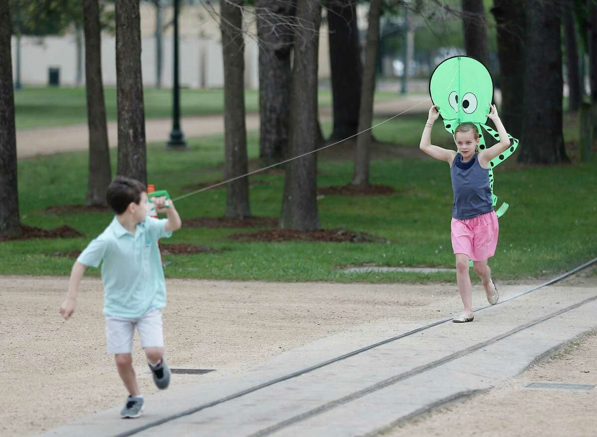 Will , age 8 and his sister Mary Elizabeth Garvey , age 9, fly an octopus kite at Hermann Park on Monday, March 14, 2016 in Houston, TX. The children were there to promote the 3rd Annual Hermann Park Conservatory Kite Festival to be held Sunday April 3, 2016 from 10 am to 5 pm. ( Photo by Thomas B. Shea / For the Chronicle)