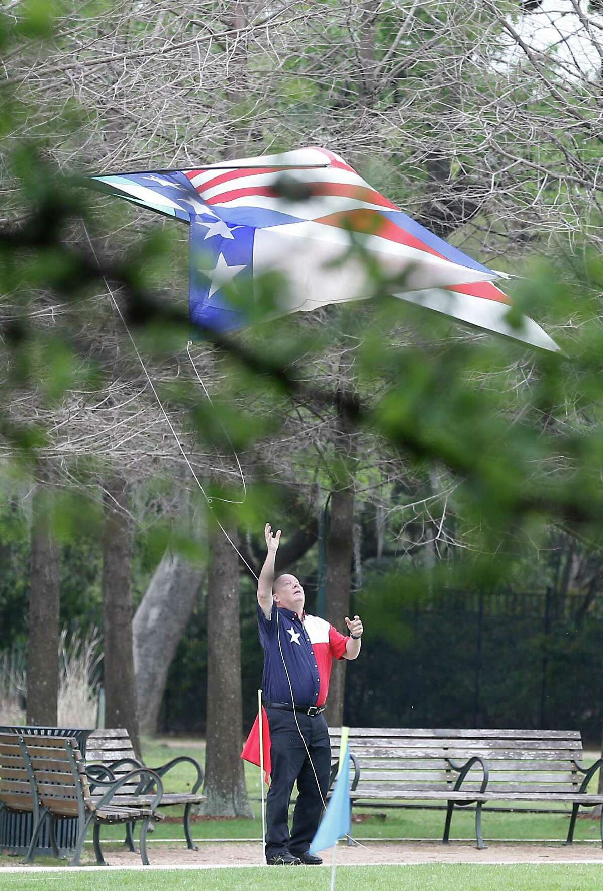 Rick Hawkins, with South Houston Area Recreation Kite Flyers, flies a giant Texas kite at Hermann Park in preparation for the third annual Kite Festival scheduled for Sunday.