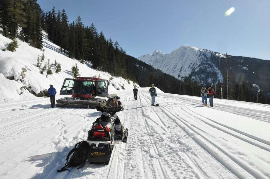 """""""Assessment Trip, reopening SR 20 - North Cascades Highway –the snow cat crew and the snowmobile crew met below Whistler, about halfway between Washington and Rainy Passes, for lunch."""" -WSDOT Photo: Courtesy Washington State Department Of Transportation / 2016 WSDOT"""