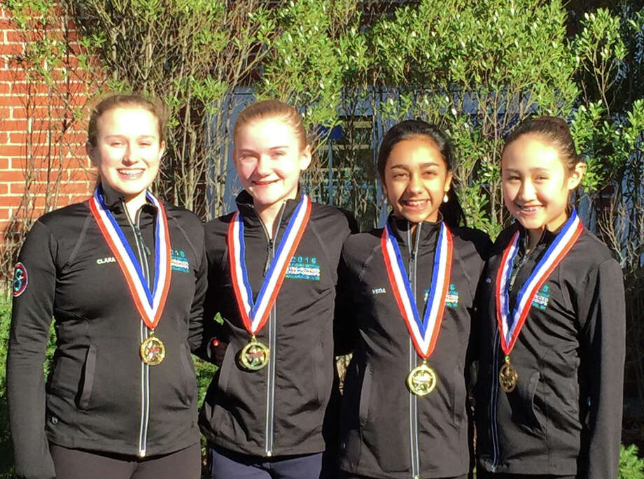 The darien gold medalists with their nationals jacket and medal. From left: Clara Baurmeister, Mae Archie, Veda Malhotra, Mia Sparks. Photo: Contributed / Darien News