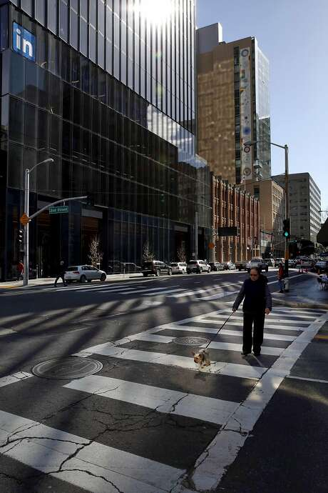 Above: Sunlight reflects off the overlapping glass panes of the new tower at 222 Second St. onto a crosswalk below. Photo: Connor Radnovich, The Chronicle