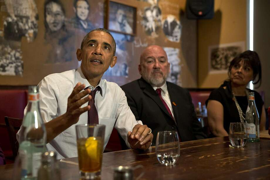 In March, President Obama met with two former federal inmates at a Washington, D.C., restaurant after commuting their prison sentences. Photo: Jacquelyn Martin, AP