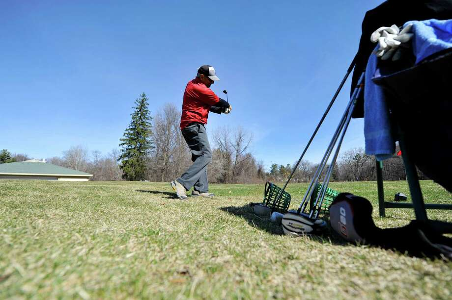 Like the looks of this? It won't last. Keep clicking for more spring photos before a little more winter returns. Richard Villa of Schenectady practices on the driving range at the Schenectady Municipal Golf Course on Wednesday, March 30, 2016, in Schenectady, N.Y.  The course is now open for the season.   (Paul Buckowski / Times Union) Photo: PAUL BUCKOWSKI / 10036006A