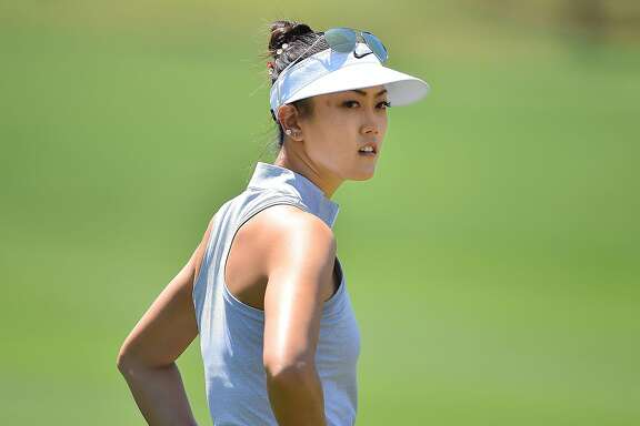 CHON BURI, THAILAND - FEBRUARY 26: Michelle Wie of the United States looks on during day two of the 2016 Honda LPGA Thailand at Siam Country Club on February 26, 2016 in Chon Buri, Thailand.  (Photo by Thananuwat Srirasant/Getty Images)