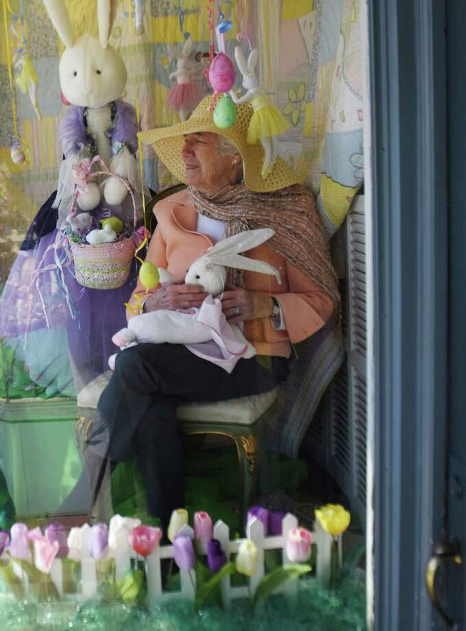 """Rummage Room volunteer Persis Alden sits in the window as a """"human mannequin"""" at The Rummage Room in Greenwich, Conn. Wednesday, April 1, 2015. The Rummage Room did its annual April Fool's Day joke with human mannequins in the shop window dressed up in Rummage Room clothes surprising passersby by waving and jumping out at them. Photo: Tyler Sizemore / Tyler Sizemore / Greenwich Time"""
