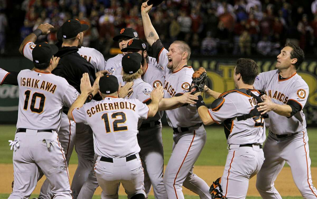 Aubrey Huff , (center) celebrates with the team as the San Francisco Giants take game 5 to win the 2010 World Series over the Texas Rangers on Monday Nov. 1, 2010 in Arlington, Tx., with a score of 3-1.