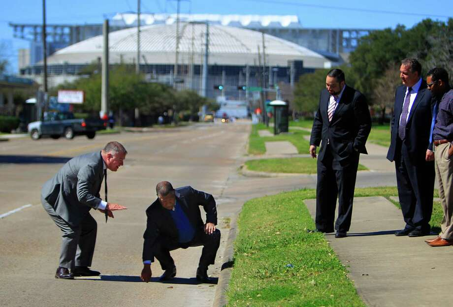 Harris County Precinct 1 Commissioner Gene Locke (right) feels a section of road near NRG stadium he intends to have fixed before the Super Bowl comes to Houston in 2017 during a tour with county engineer John Blount (left), Thursday, Feb. 25, 2016, in Houston. Photo: Mark Mulligan, Houston Chronicle / © 2016 Houston Chronicle