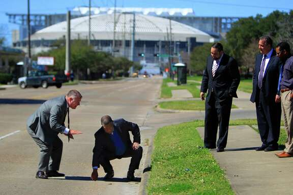 Harris County Precinct 1 Commissioner Gene Locke (right) feels a section of road near NRG stadium he intends to have fixed before the Super Bowl comes to Houston in 2017 during a tour with county engineer John Blount (left), Thursday, Feb. 25, 2016, in Houston.