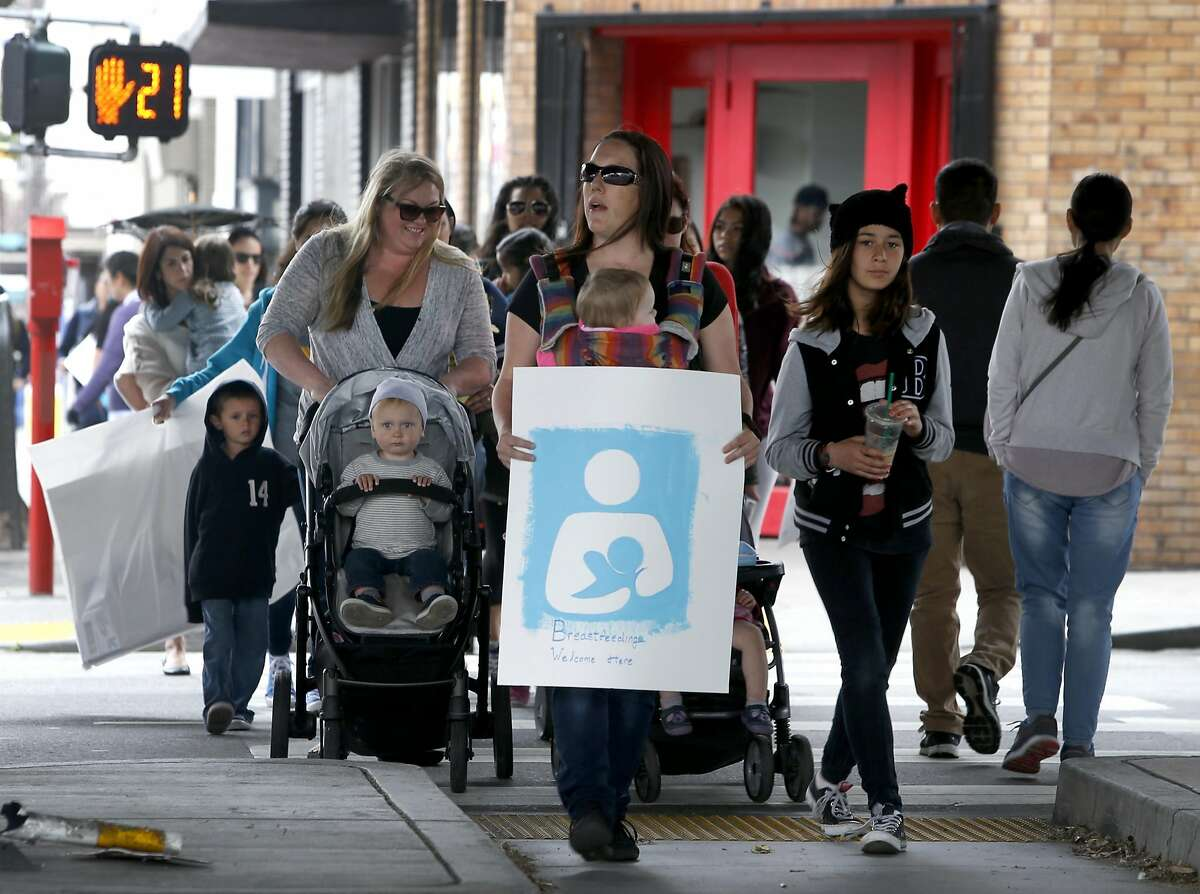Mothers march with their children to the city's Human Services Agency in San Francisco, Calif. on Wednesday, March 30, 2016 for a group breast feeding after Mildred Musni was forced to cover up by a security guard when she attempted to breast feed her son Eliseo inside the facility a few months ago.