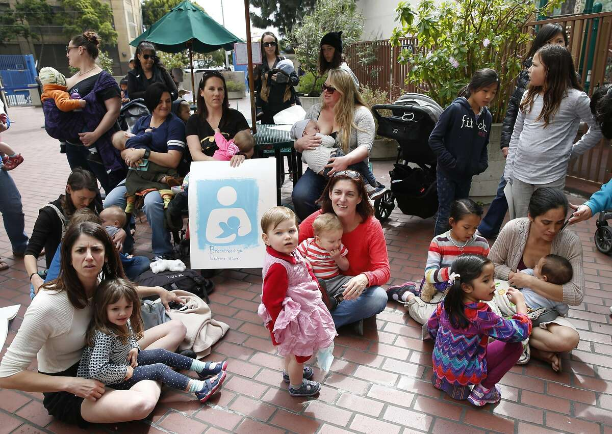 Mothers gather at the main entrance of the city Human Services Agency to breast feed their babies in San Francisco, Calif. on Wednesday, March 30, 2016 in protest after Mildred Musni (lower right) was forced to cover up by a security guard while she was breast feeding her son Eliseo inside the facility a few months ago.