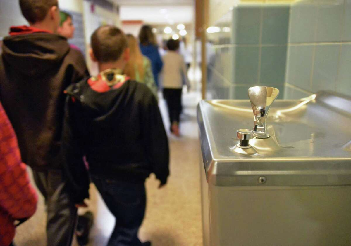 Elementary students walk past a drinking fountain at Hoosick Falls Central School Tuesday Jan. 26, 2016 in Hoosick Falls, NY. (John Carl D'Annibale / Times Union)