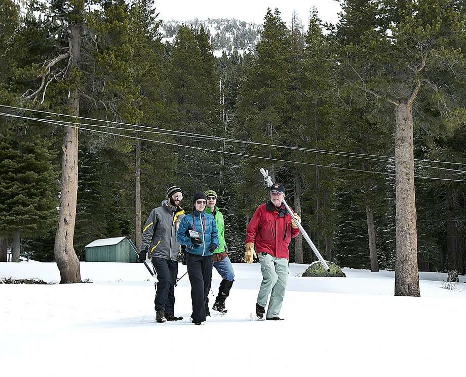 Frank Gehrke, right, chief of the California Cooperative Snow Surveys Program for the Department of Water Resources, leads John Thompson, left, Sarah Carvill, center, and Dan Brumbaugh, Science Policy Fellows from the California Council on Science and Technology, across a snow covered meadow as he conducts the snow survey at Phillips Station near Echo Summit, Calif., Wednesday, March 30, 2016. The survey showed the snowpack at about 95 percent of normal for this site at this time of year. Photo: Rich Pedroncelli, AP