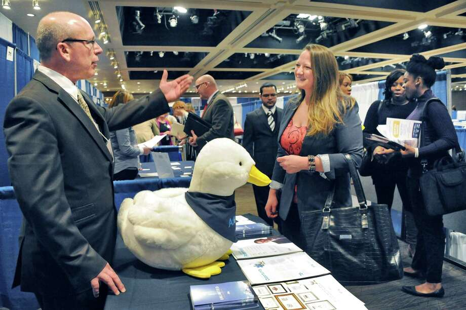 Aflac recruiter Jim Staats, left, speaks with Candice Dunham of East Berne during the Dr. King Career Fair at the Empire State Plaza Convention Center Wednesday March 30, 2016 in Albany, NY.  (John Carl D'Annibale / Times Union) Photo: John Carl D'Annibale / 10035983A