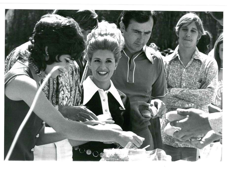 The first Oyster Bake was held on the San Antonio River in 1916, when alumni gathered for their annual meeting.In this photo from 1971, guests wait in a food line. Photo: Courtesy, St. Mary's University